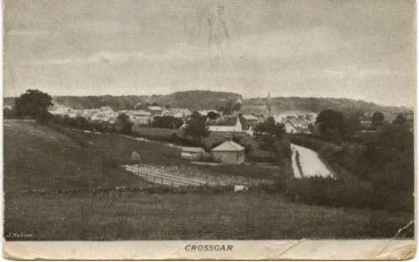 Figure 2: Old postcard photo of Crossgar showing Catholic Church spire. Courtesy of Nancy Schaalje on rootsweb.