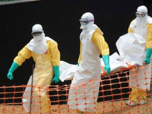 Staff of the 'Doctors without Borders' medical aid organization carry the body of a person killed by the Ebola virus.